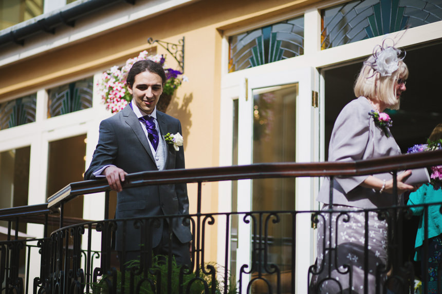 groom on balcony