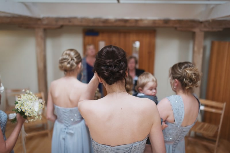 Bridesmaids waiting outside ceremony room