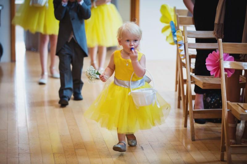 Flower girl walking down aisle