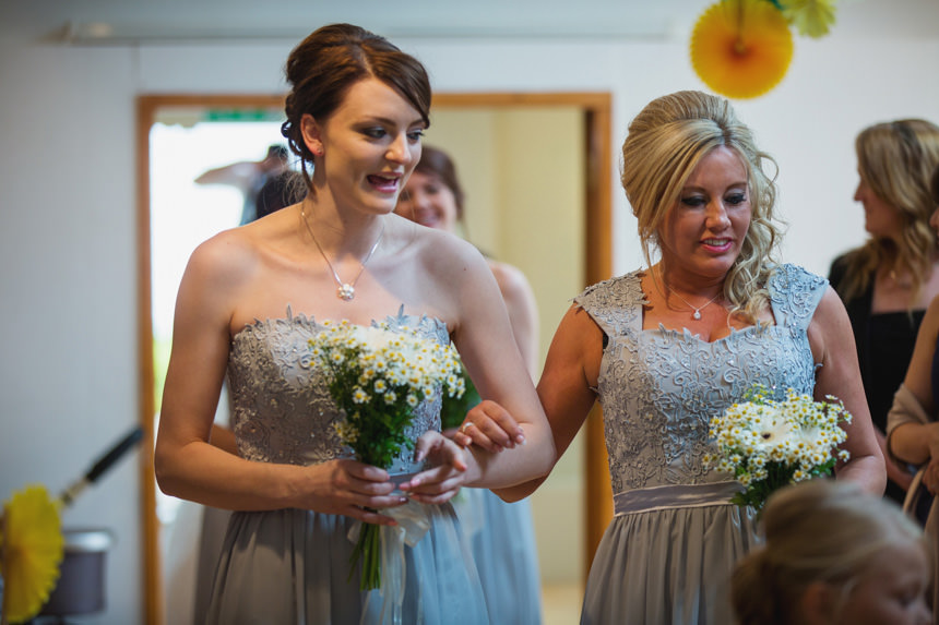 Bridesmaids walking down aisle
