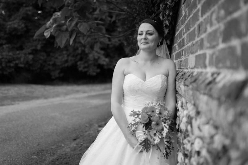 bride leaning against wall