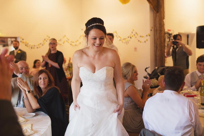 bride walking through guests