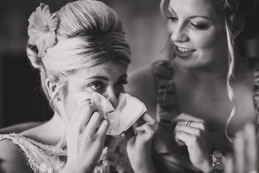 bride wiping eyes