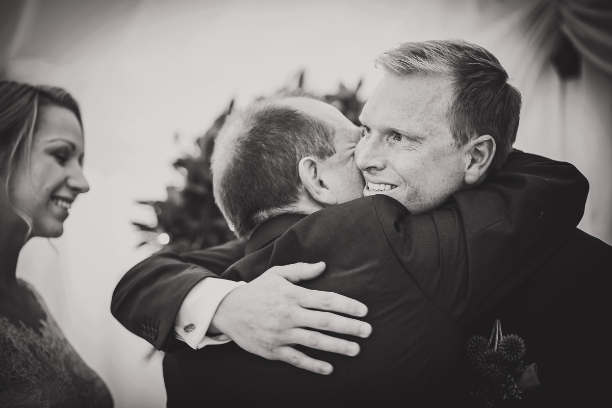 groom hugging father