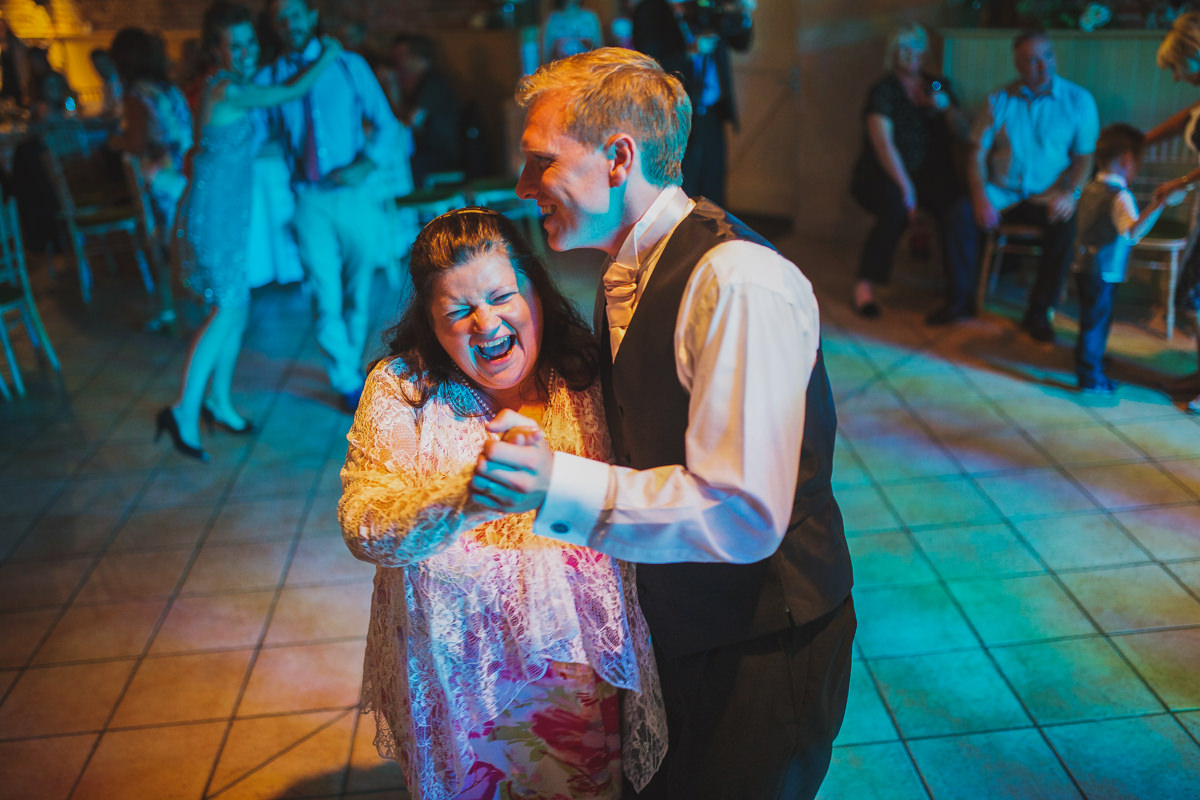 groom dancing with guest