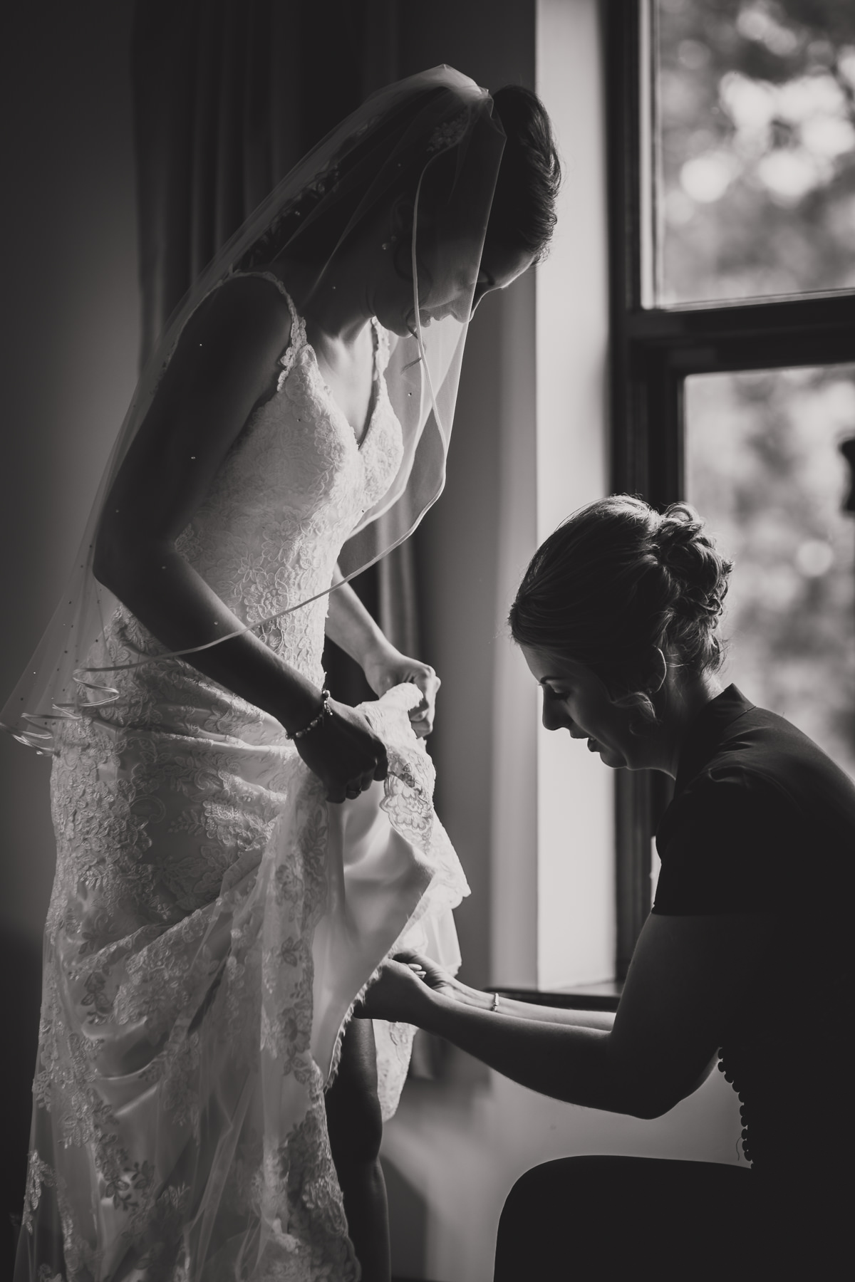 bride putting on garter