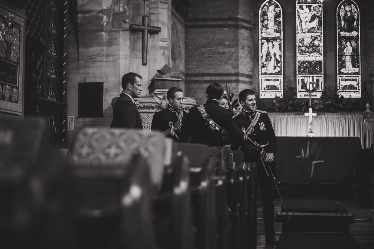 groom's party at front of church