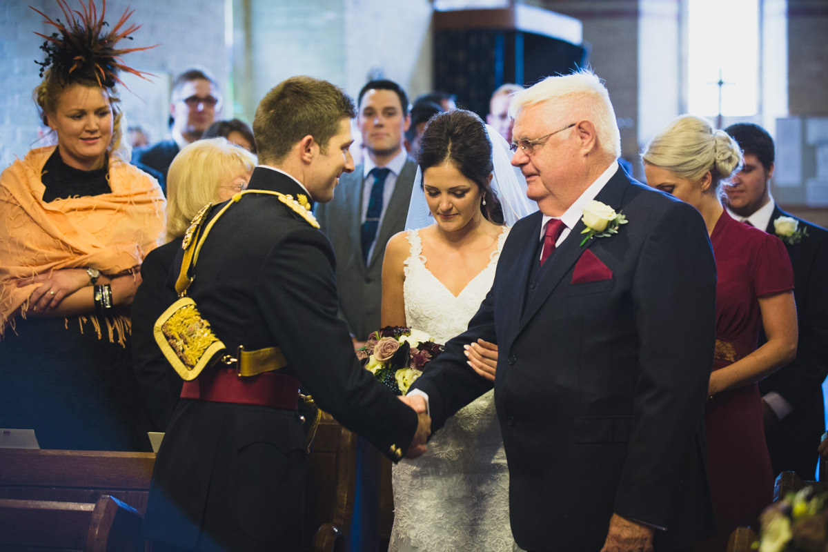 bride reaches groom