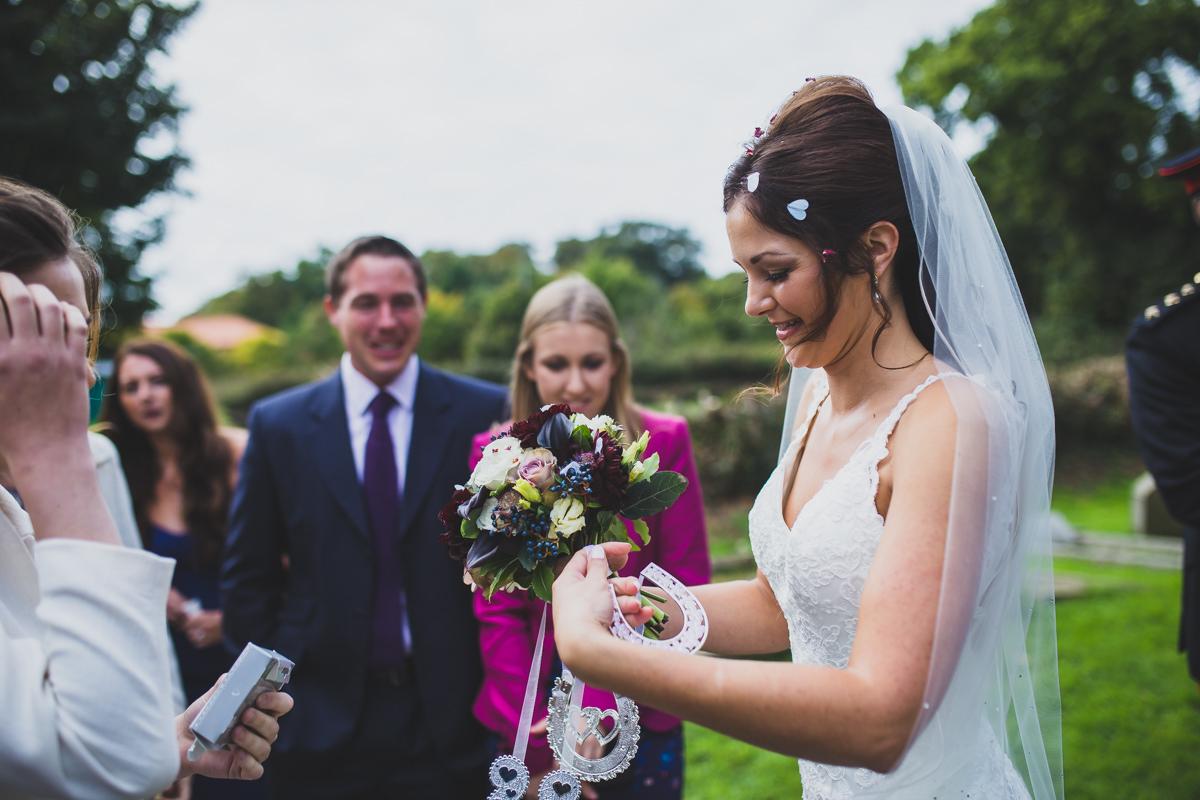 bride receiving lucky horseshoe