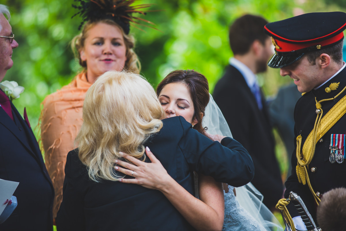 bride hugging guest
