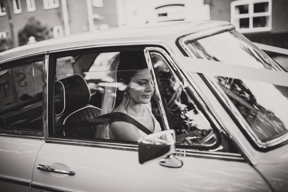 black and white bride in car