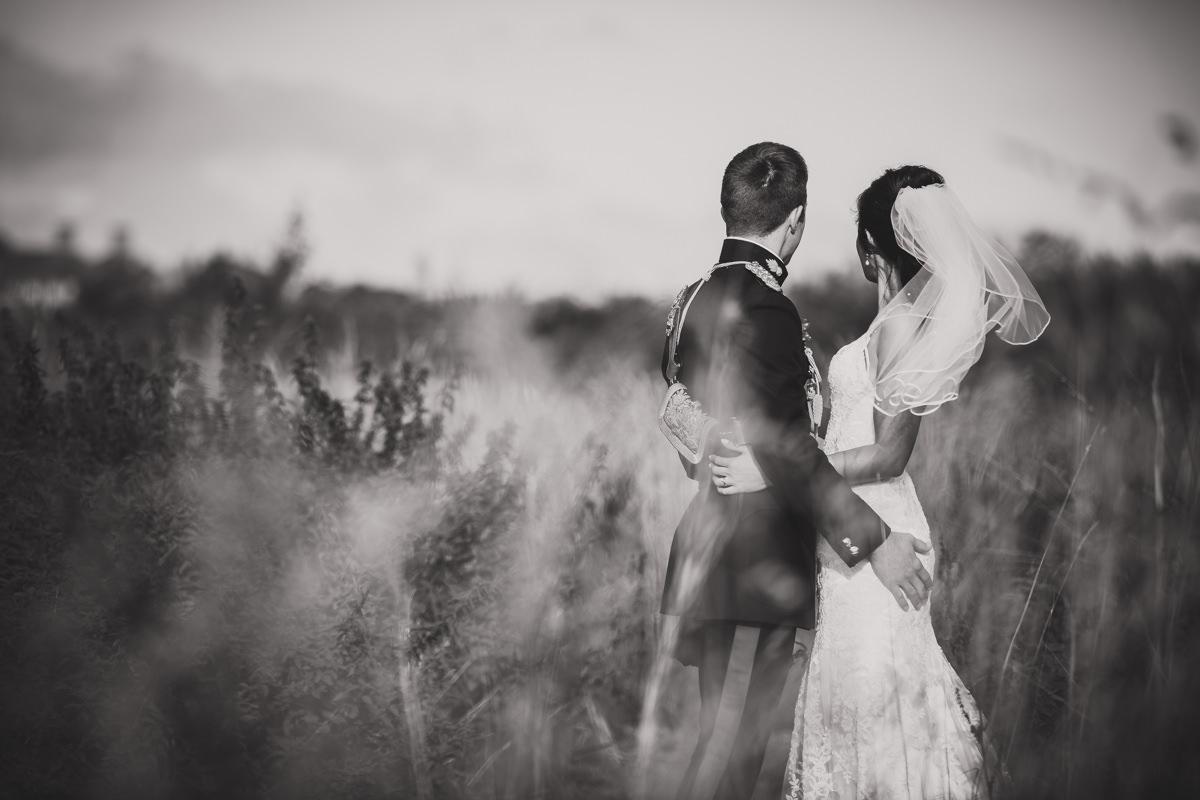 bride and groom looking away