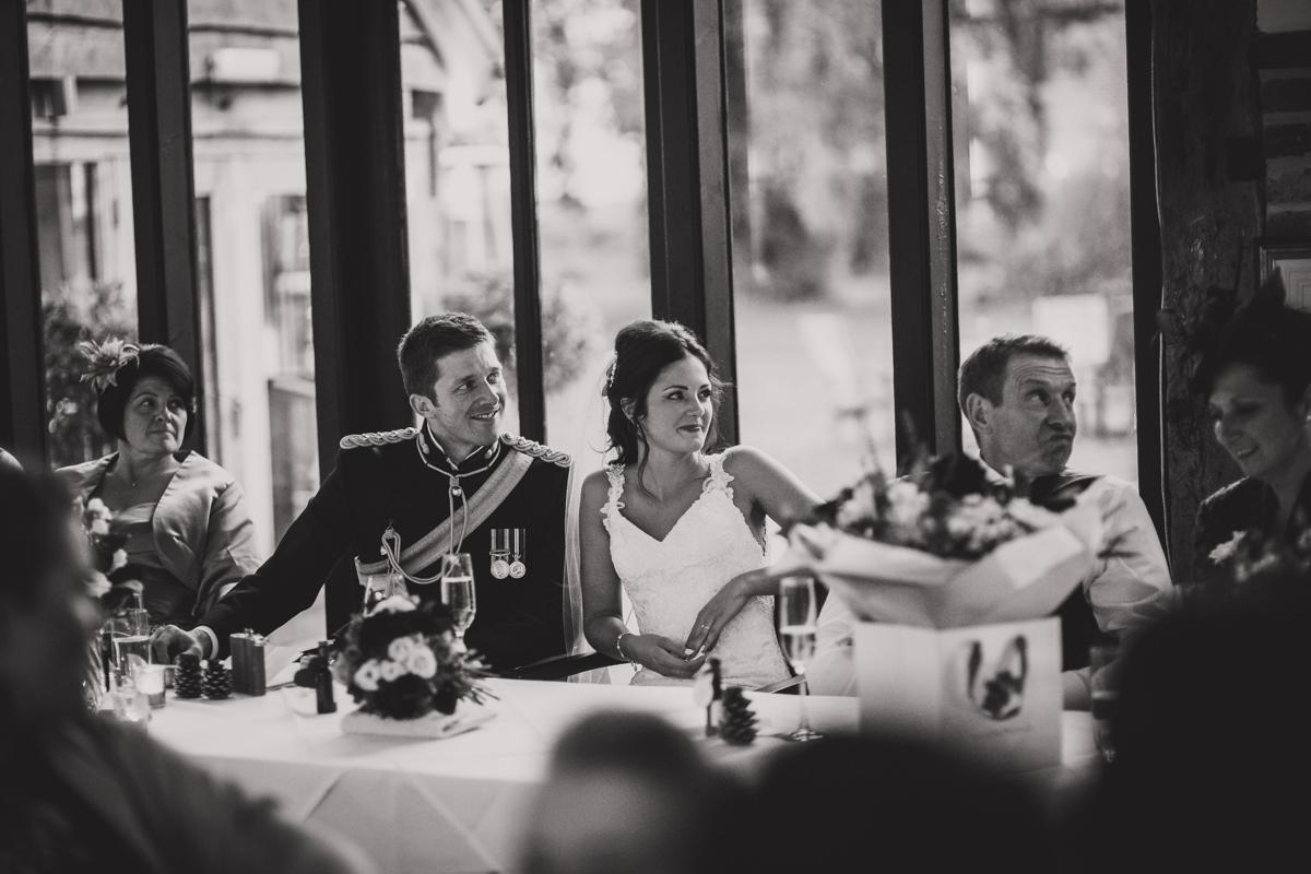 bride and groom listening to best man speech