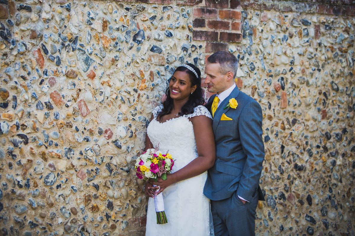 groom standing behind groom