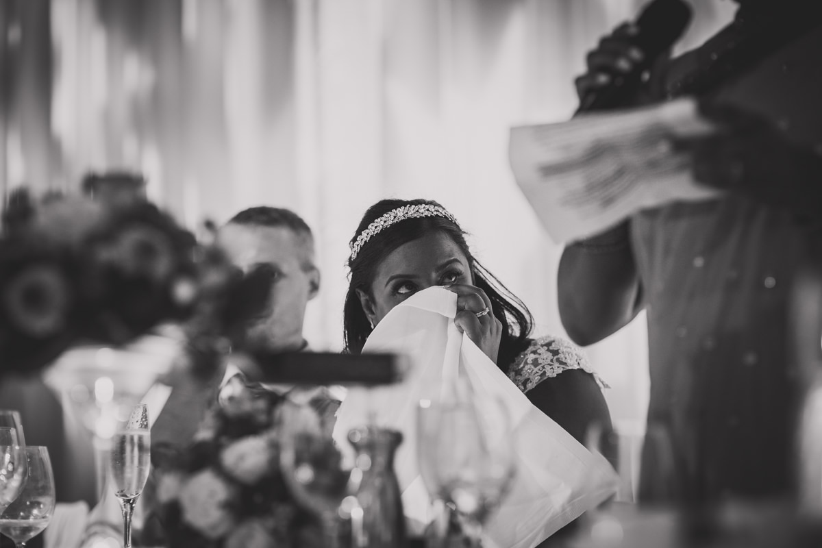 bride wiping tear from eye
