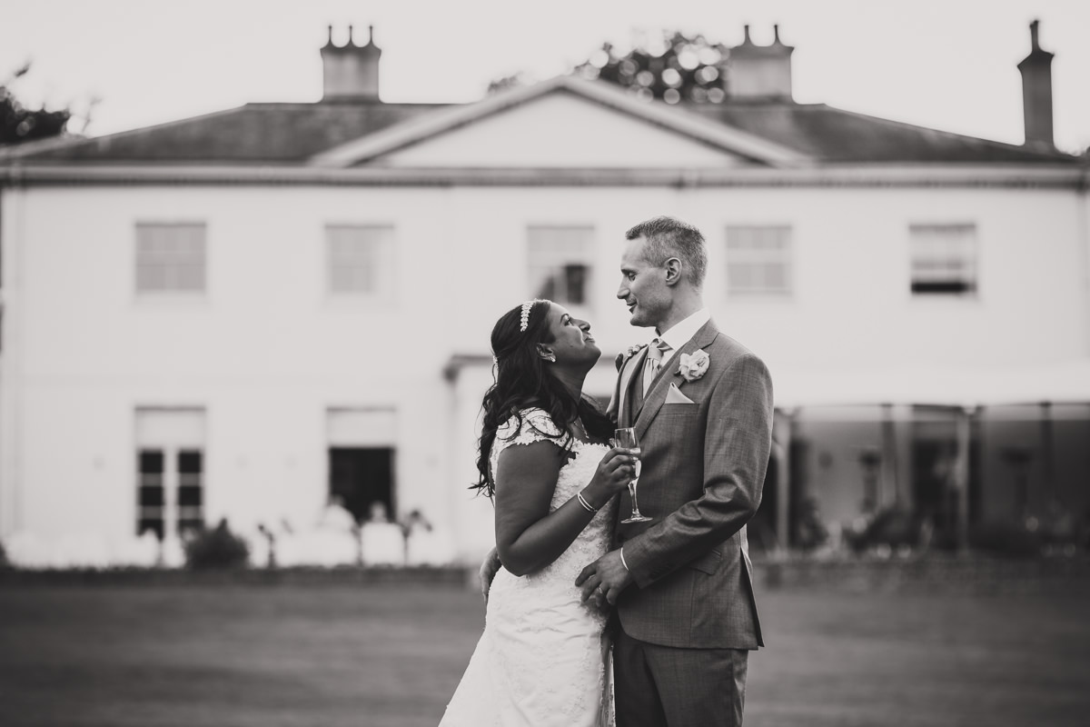 bride and groom in front of Kesgrave Hall