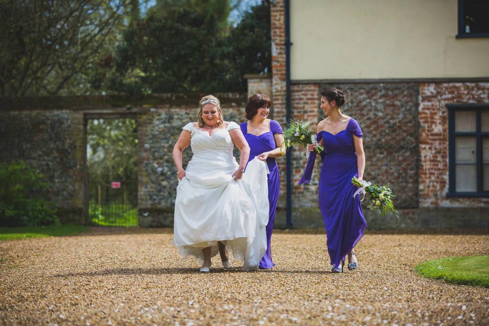bride walking with bridesmaids