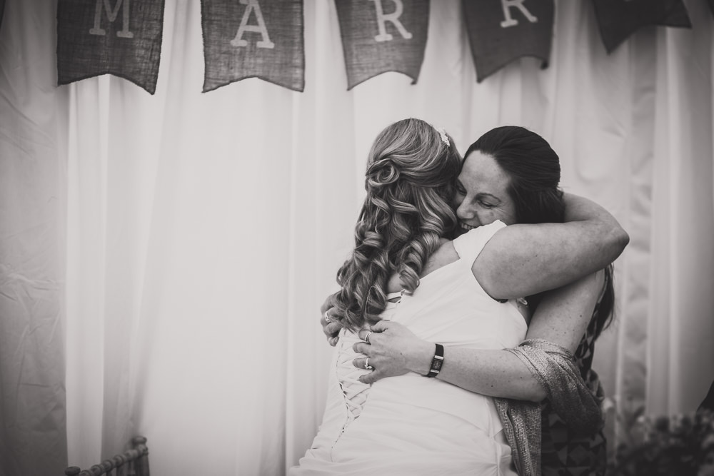 bride hugging bridesmaid