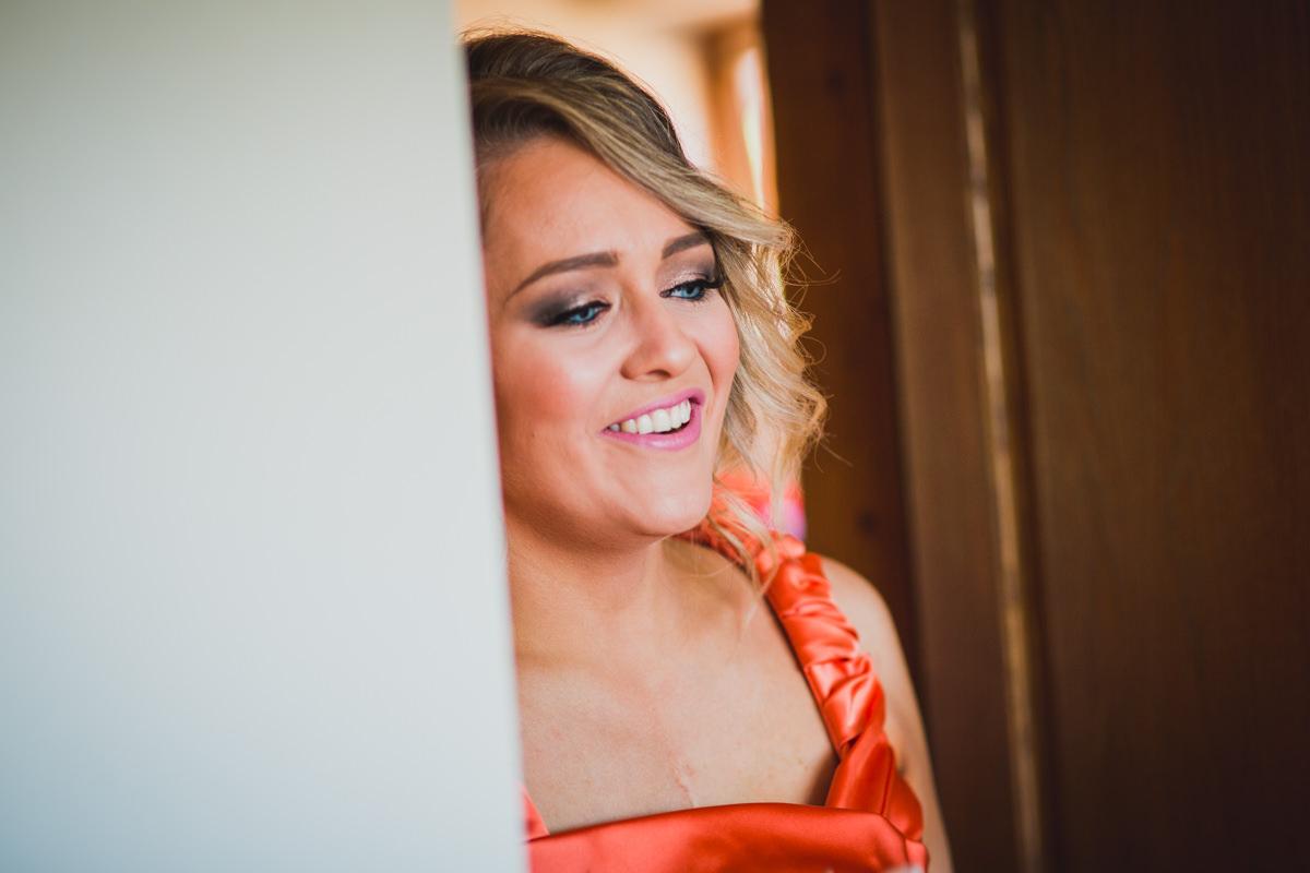bridesmaid smiling at bride