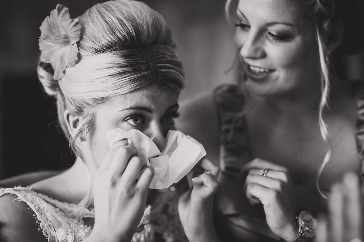 bride getting teary with father