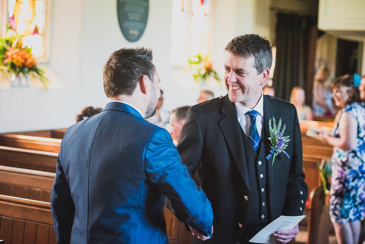 groom greeting guest