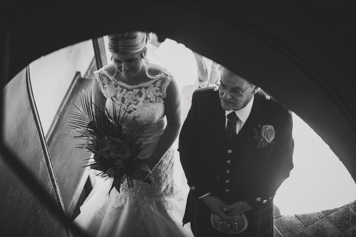 bride and father waiting at church door