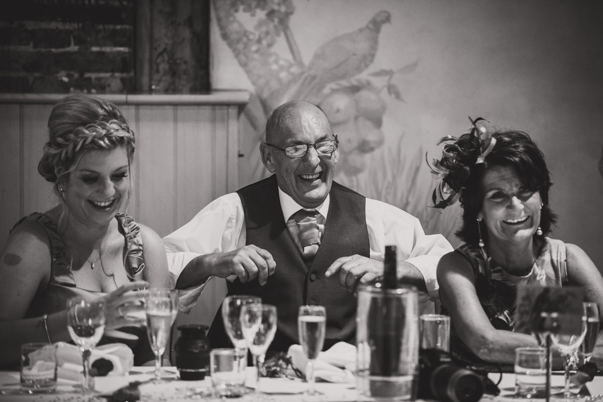 father of groom laughing