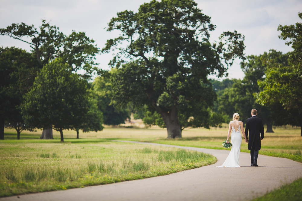bride and groom walking down road