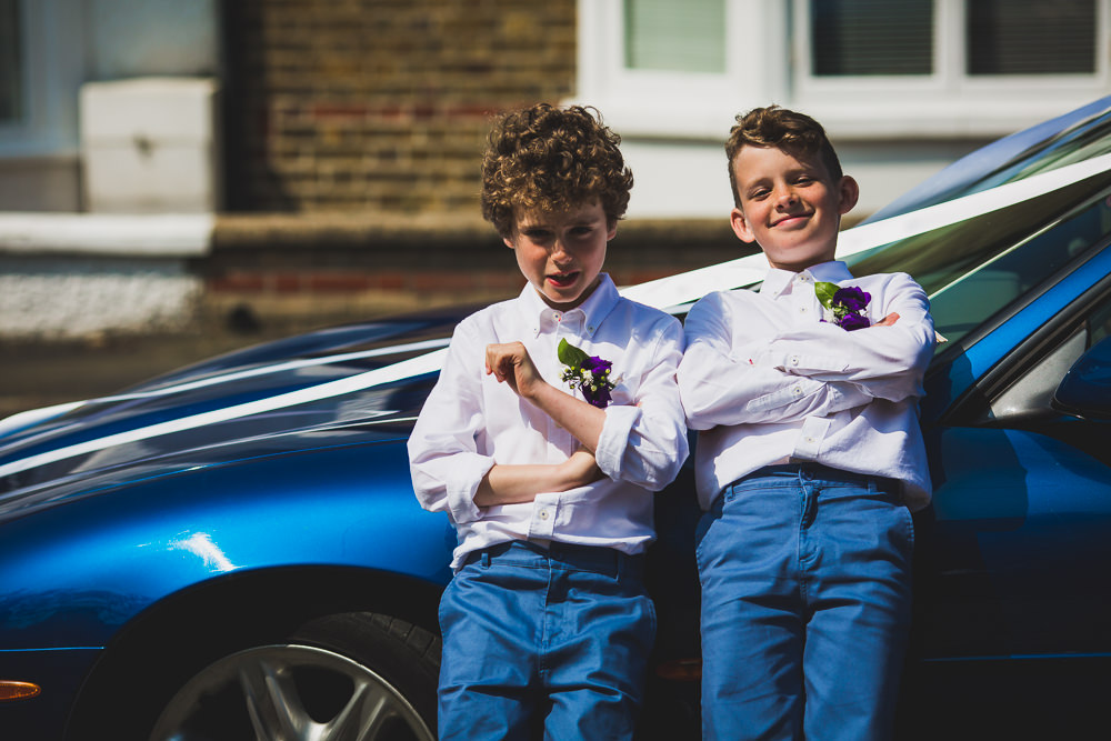 page boys leaning on car