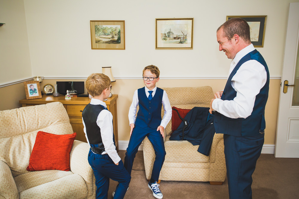 groom with sons in living room