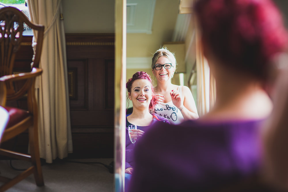 bride smiling in mirror