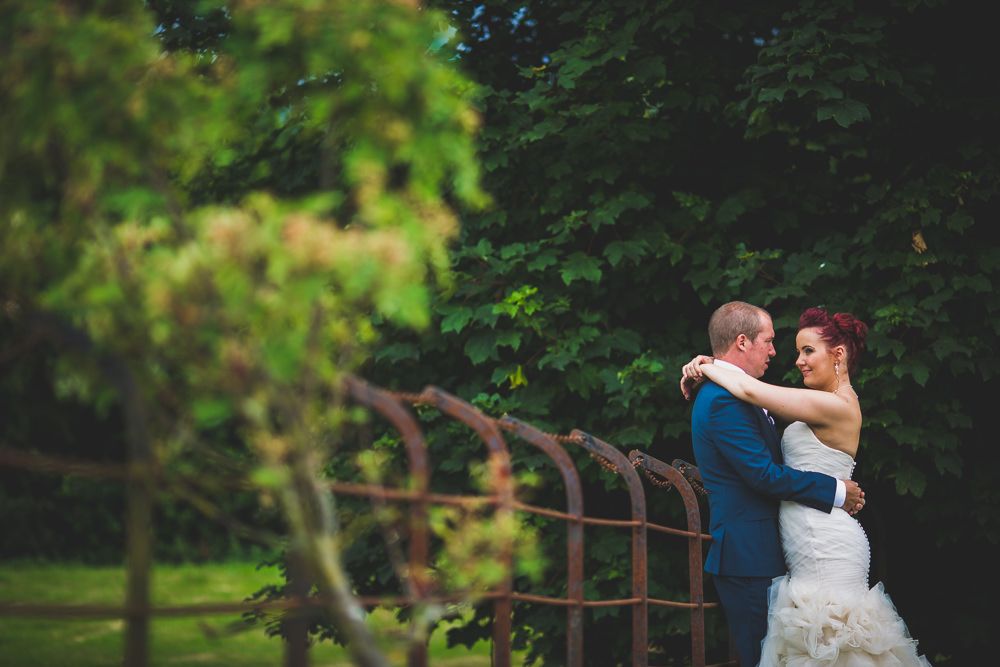 bride with arms around groom