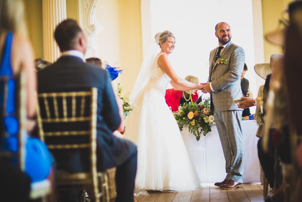 bride and groom facing crowd