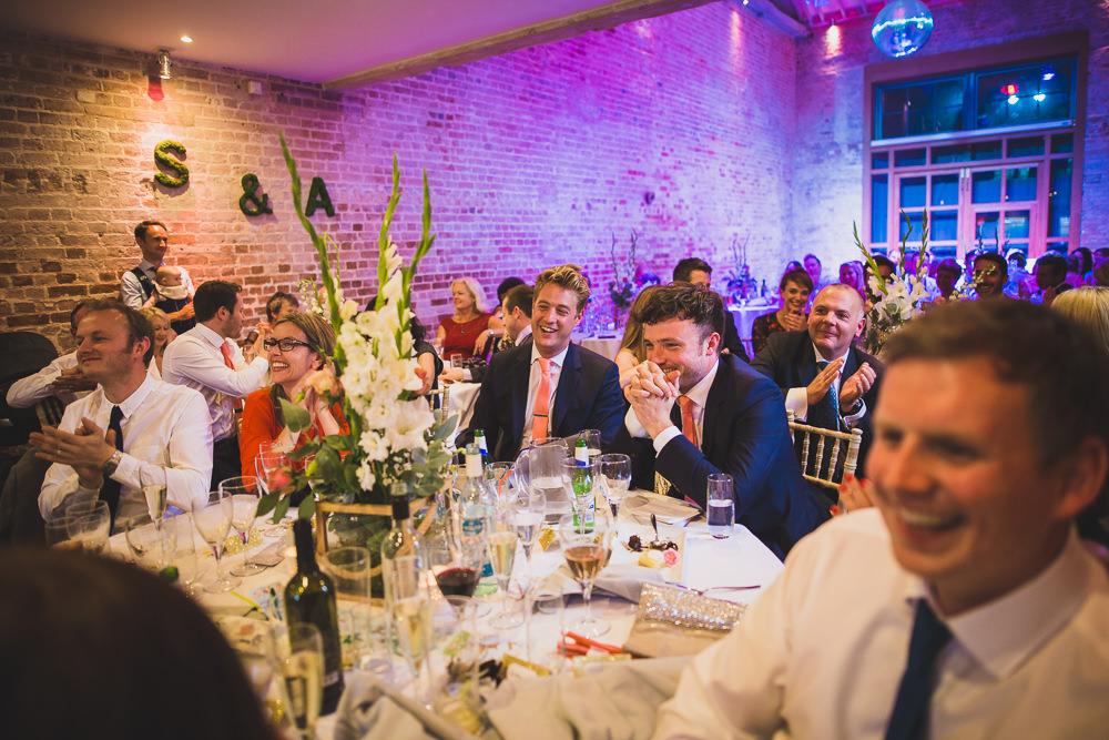 best men laughing at groom's speech