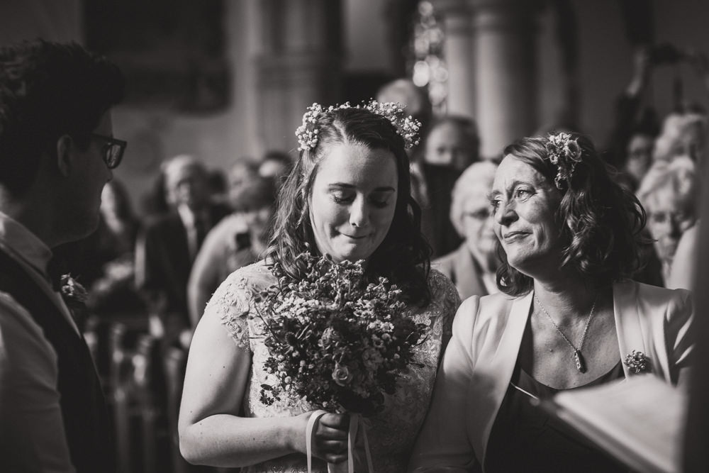 bride with mother at alter