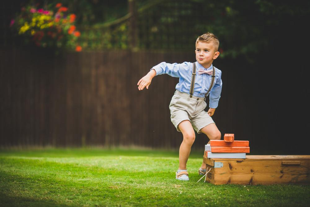 young boy playing with giant jenga