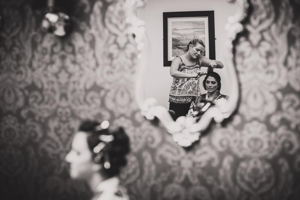 Bridesmaid reflection in mirror