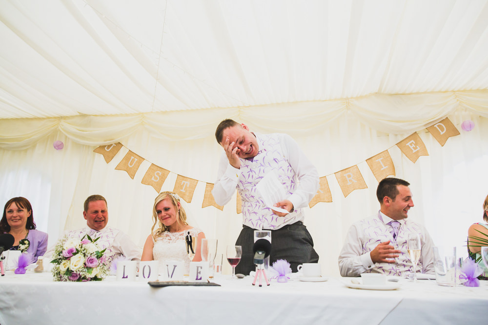 groom wiping tear during speeches