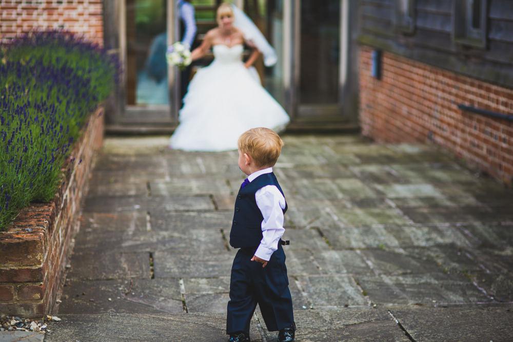 page boy looking back at mum