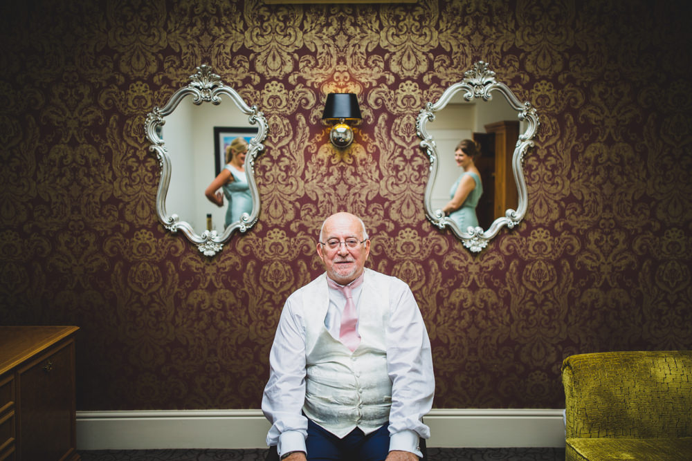 father of bride between two mirrors